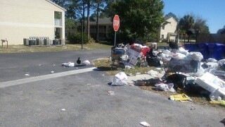 TRASH TROUBLE: Trash piles up at apt complex