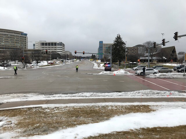Police clear the road for the procession from the hospital.
