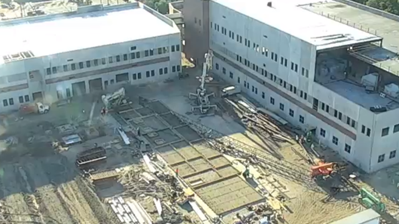 Large crane falls on its side at construction site for new