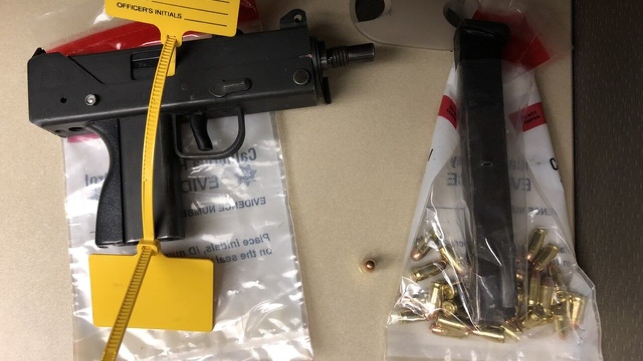 Man arrested for possession of loaded Mac 12