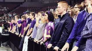 York students wear purple to state in support of opposing team's assistant coach