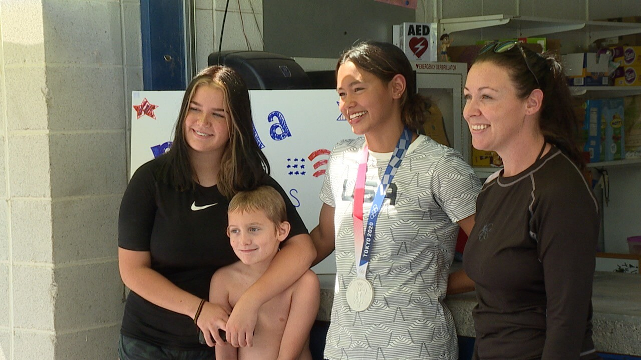 Bella Sims takes pictures with community members at Vale City Pool .jpg