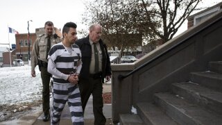 Cristhian Bahena Rivera walks into the Poweshiek County Courthouse for day two of an evidence suppression hearing on Thursday, Nov. 14, 2019, in Montezuma, Iowa. Bahena Rivera confessed to killing Mollie Tibbetts last year but his attorneys filed a motion to suppress the confession because he was not properly read his Miranda warning during initial interviews with police. (Brian Powers/The Des Moines Register via AP)
