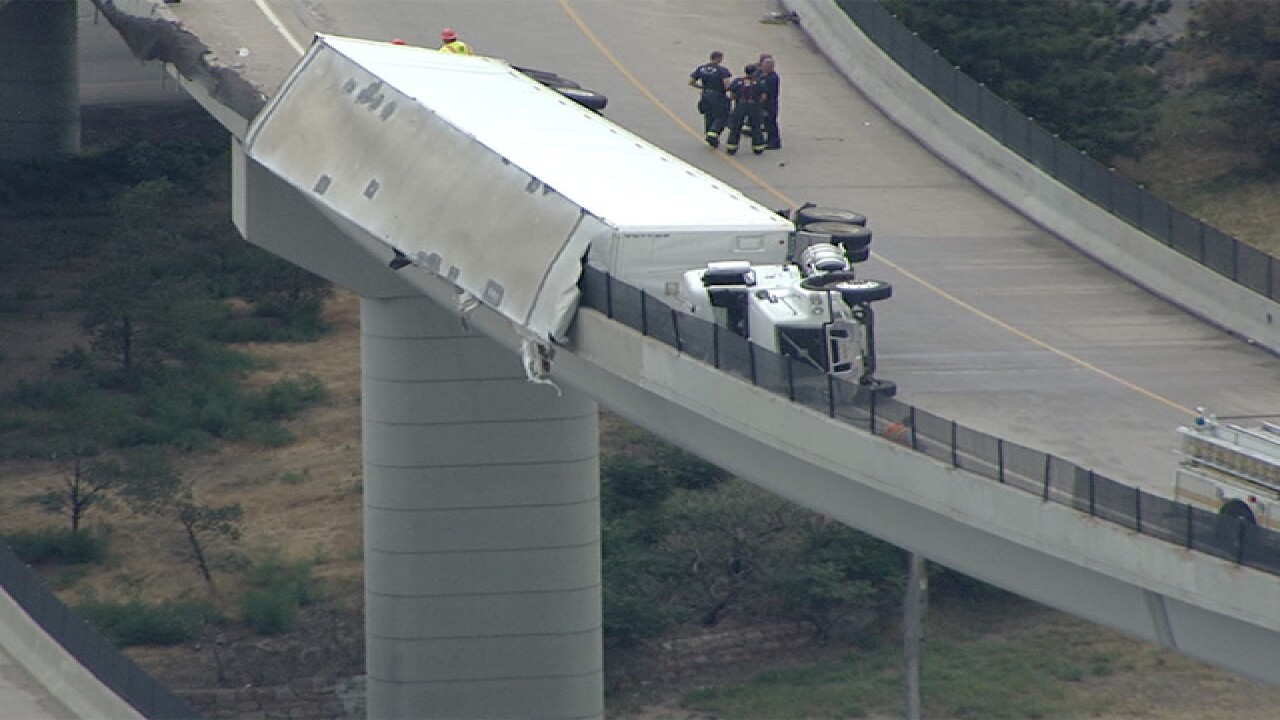 EB I-70 to NB I-25 closed due to semi crash