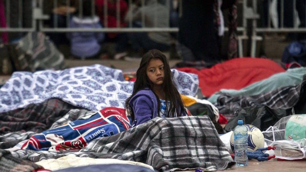 US continues processing caravan asylum requests as some remain in tents