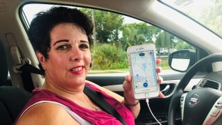 Uber driver Tricia Yarusso at work behind the wheel.