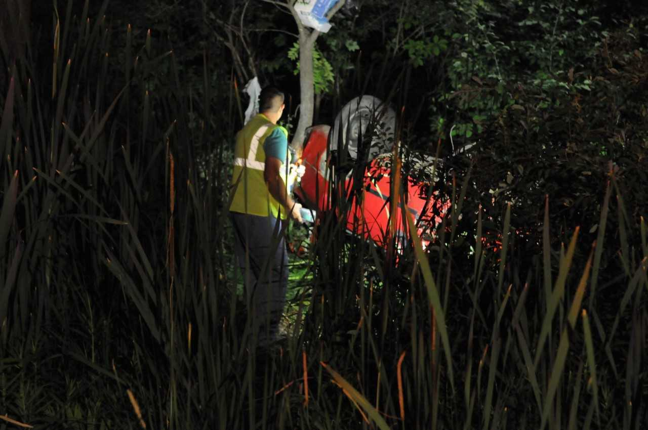Photos: Passerby finds car upside down in woods; driverdies