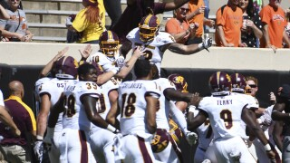 CMU stuns No. 22 Oklahoma State on final play