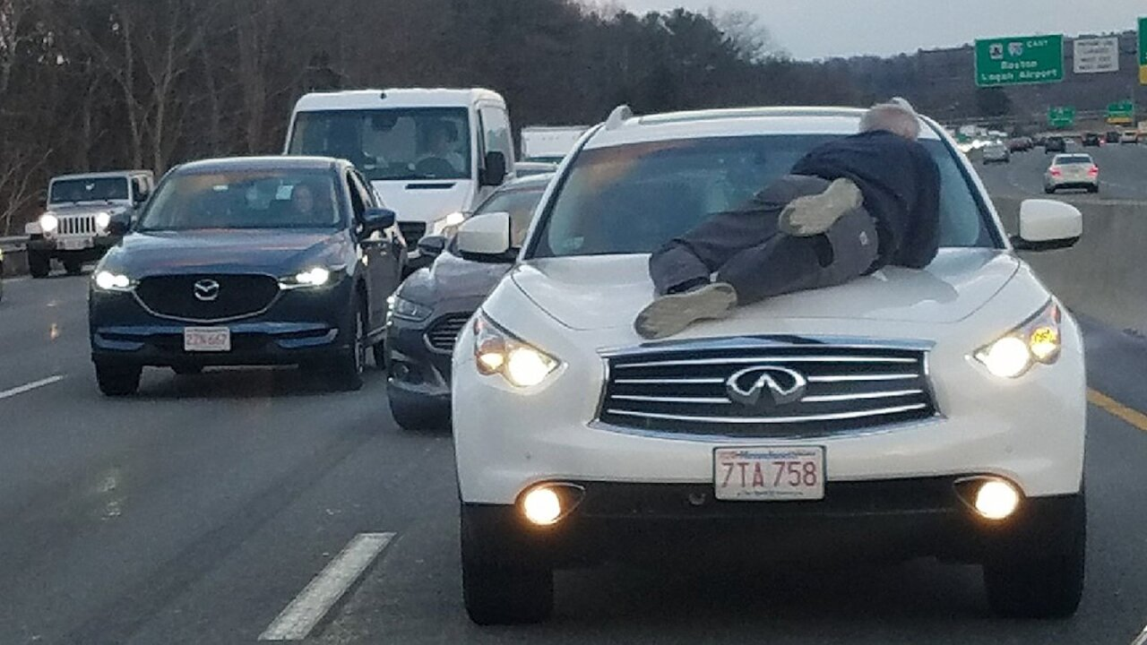 Man clings to SUV's hood during road rage incident: 'Stop the car, stop the car!'