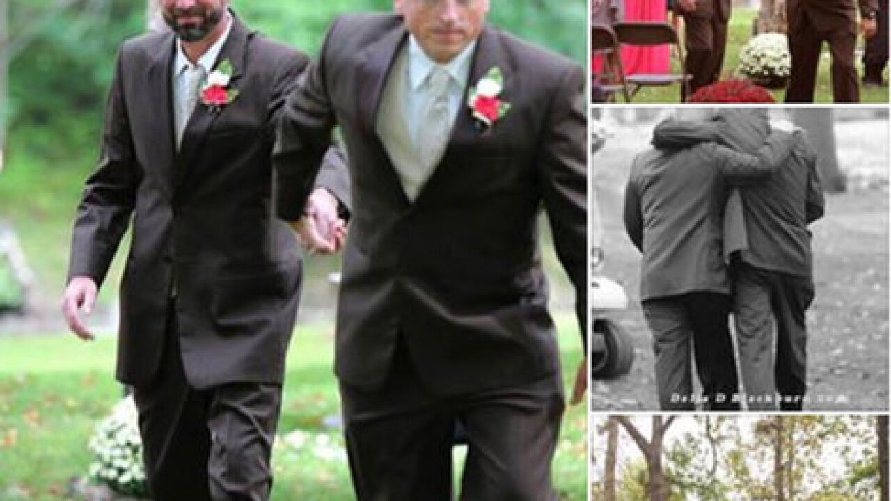 Dad of bride grabs stepfather during aisle walk
