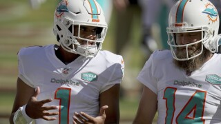 Miami Dolphins QBs Tua Tagovailoa and Ryan Fitzpatrick talk before game, Oct. 11, 2020