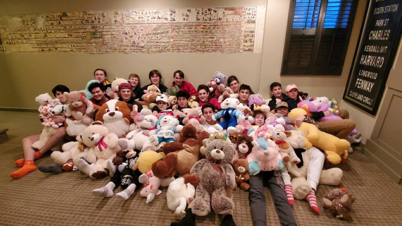 Regis Jesuit Hockey - team with kids teddy bears.jpg