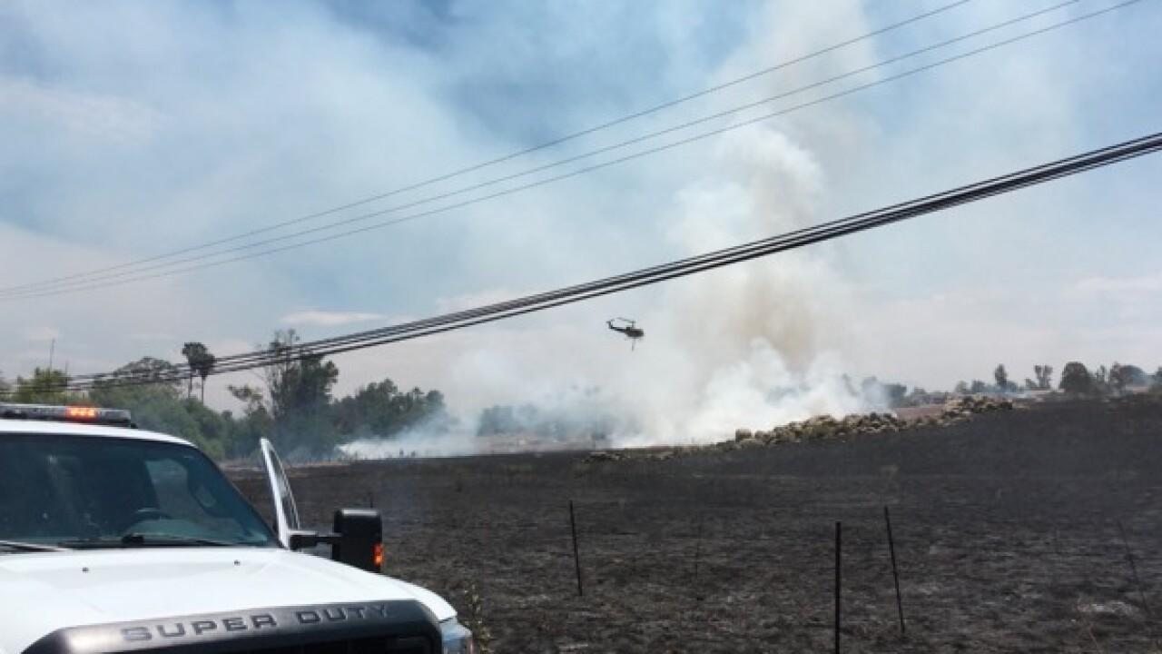 Crews battle brush fire in Ramona area