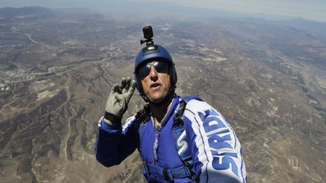 He's a skydiver working with a net, but no parachute