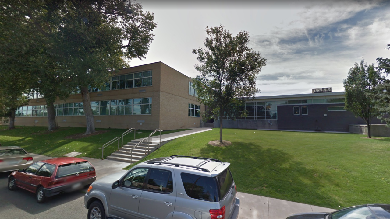 Dean at Colorado school arrested after bringing gun into school Wednesday, making threats