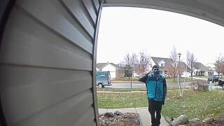Amazon delivery driver salutes house of Air National Guard member in New Baltimore