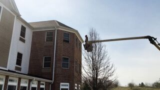 Charley Adams, 45, uses his company's bucket truck to visit his 80-year-old mother quarantined on the 3rd floor of a nursing home in New Middletown, Ohio, March 22, 2020.Charley Adams, 45, uses his company's bucket truck to visit his 80-year-old mother quarantined on the 3rd floor of a nursing home in New Middletown, Ohio, March 22, 2020. Courtesy Charley Adams