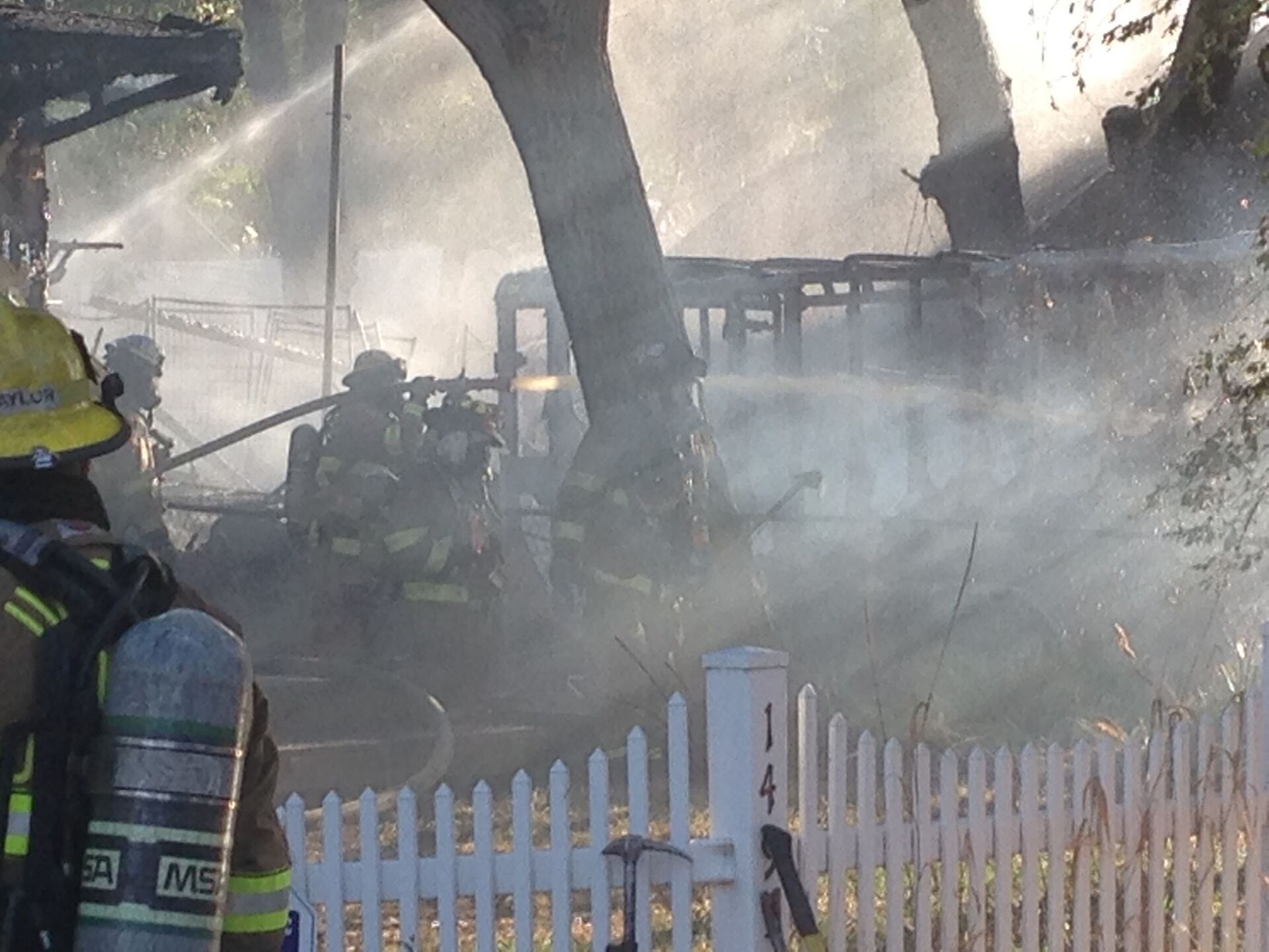 Photos: Firefighters respond to 2 alarm fire that burns 2 homes in West ValleyCity