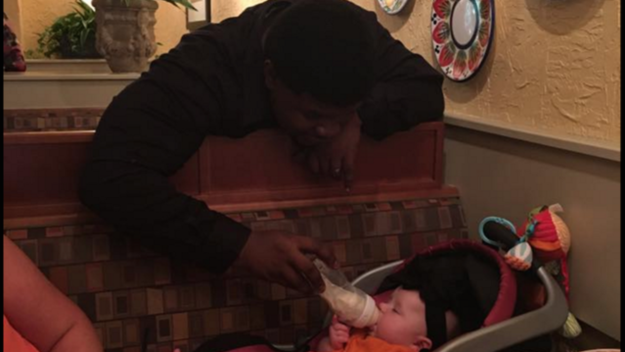 On-duty server feeds infant while mother dines