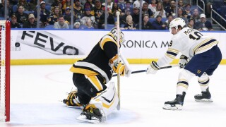 Jake McCabe scores a shorthanded goal against the Penguins