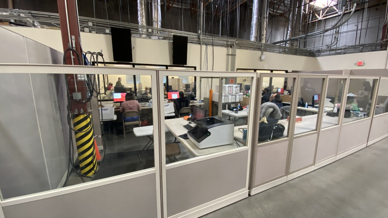 These are photos of people processing the remaining ballots at the Clark County Election Center in North Las Vegas as seen Nov. 7, 2020