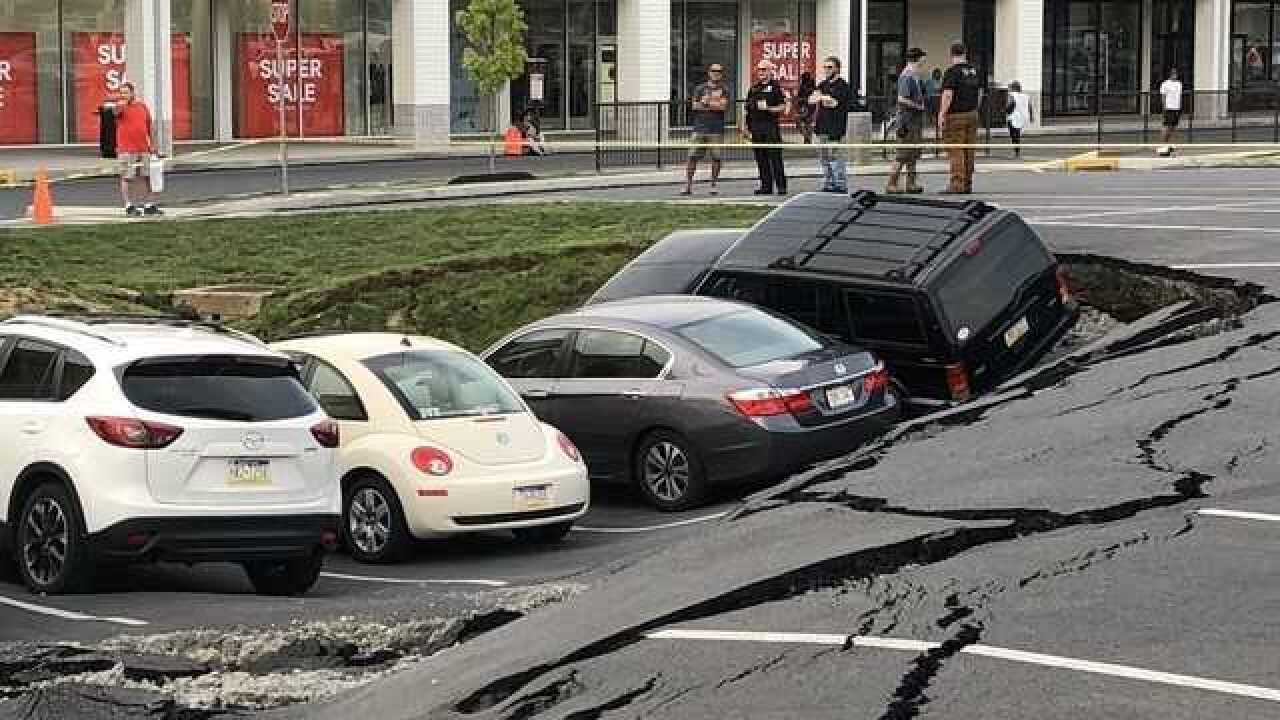 6 cars stuck in sinkhole outside Tanger Outlets
