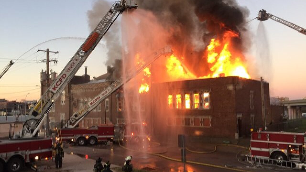 Crews battle stubborn building fire