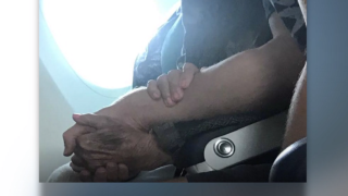 Kind stranger comforts scared 96-year-old passenger on flight