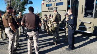 Wanted man apprehended after standoff with police