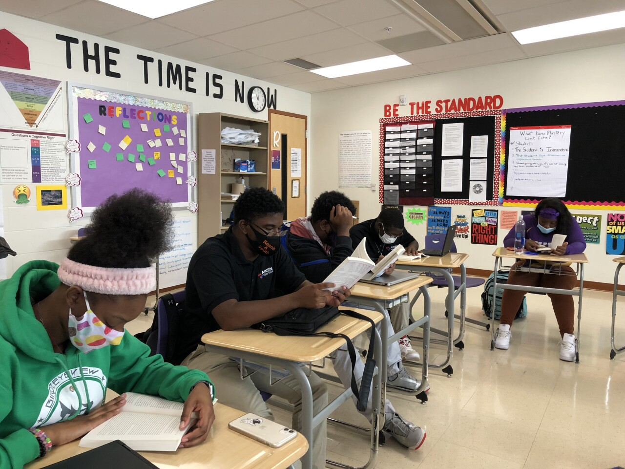 Aiken High School students read in preparation for a discussion with Keith LaMar, an inmate on death row at the Ohio State Penitentiary.