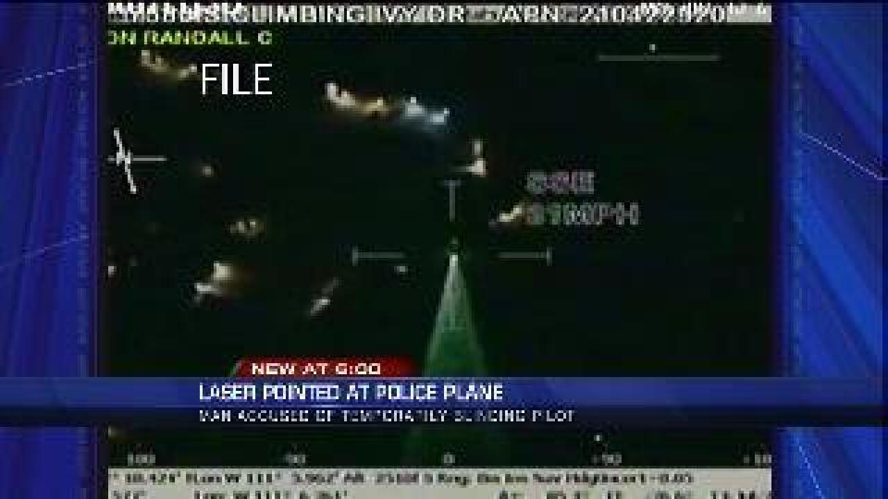 Green laser blinds state police pilot