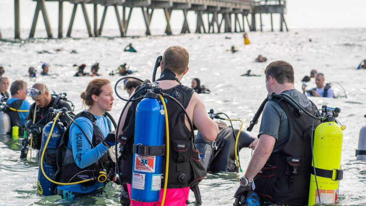 Divers set world record by collecting over 1,500 pounds of trash at a Florida beach