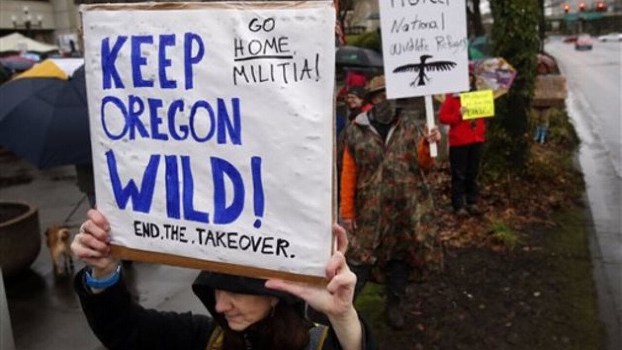 Chants of 'go' from community against militia