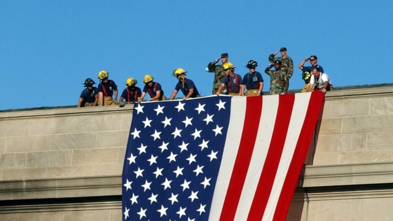 pentagon flag with wilkins saluting.jpg