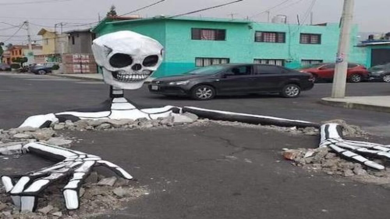 Giant Skeletons Look Like They're Bursting From The Ground In Mexico For Day Of The Dead