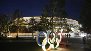US Olympic CEO tells AP why she's not demanding games' delay