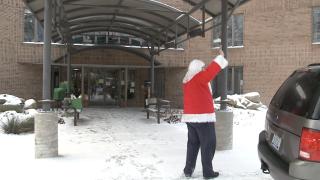 Muskegon Assisted Living Facility - Santa Waving to Residents