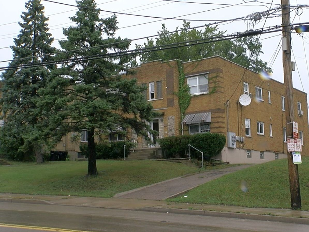 The Westwood apartment building where Valerie Lane lives. The two-story brick building contains four apartments.