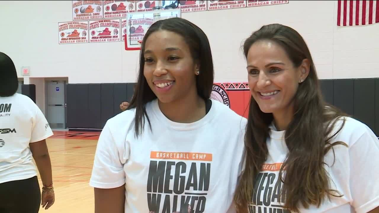 Megan Walker and her agent, Ticha Penicheiro, who played 15 years in the WNBA.