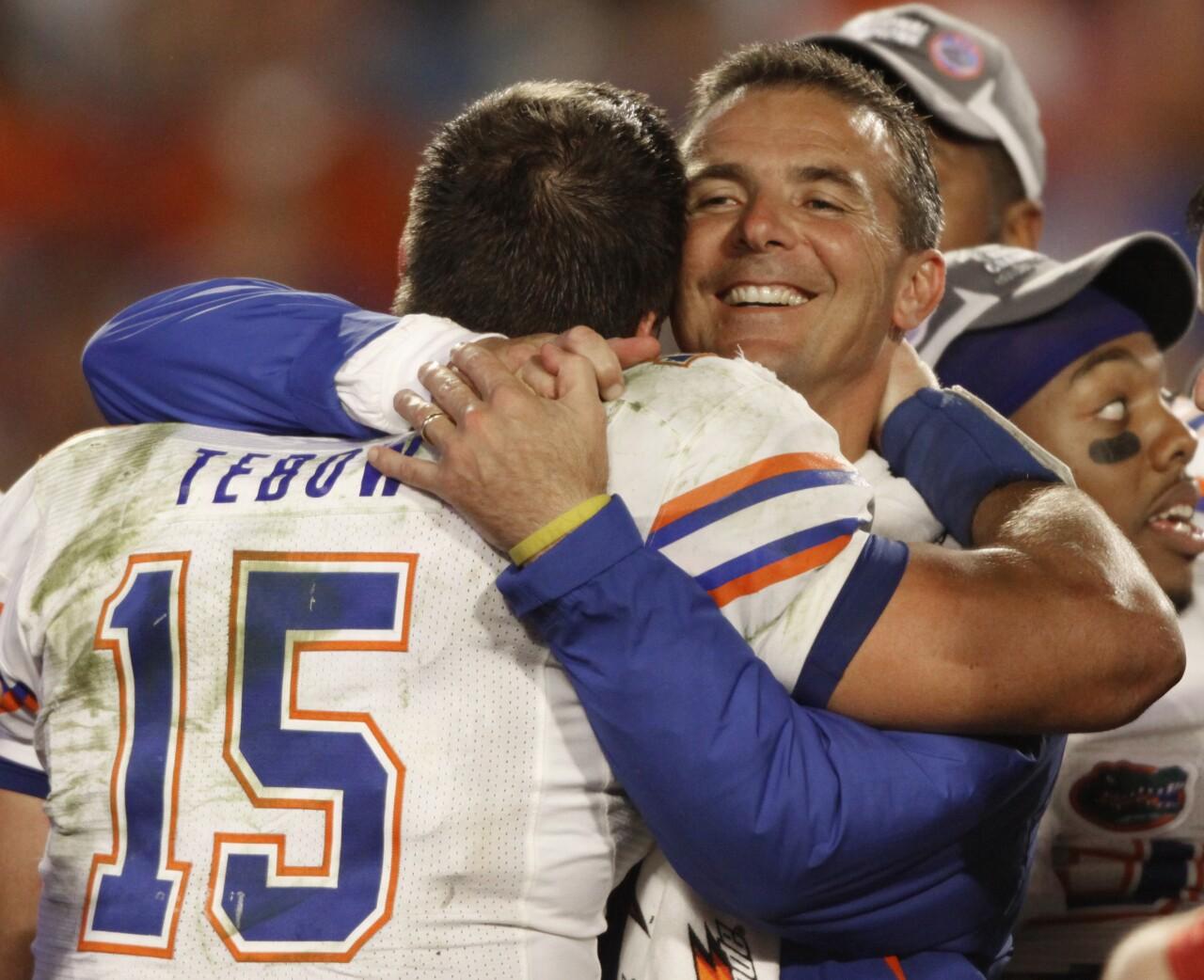 Florida Gators head coach Urban Meyer hugs QB Tim Tebow after winning 2009 BCS National Championship game