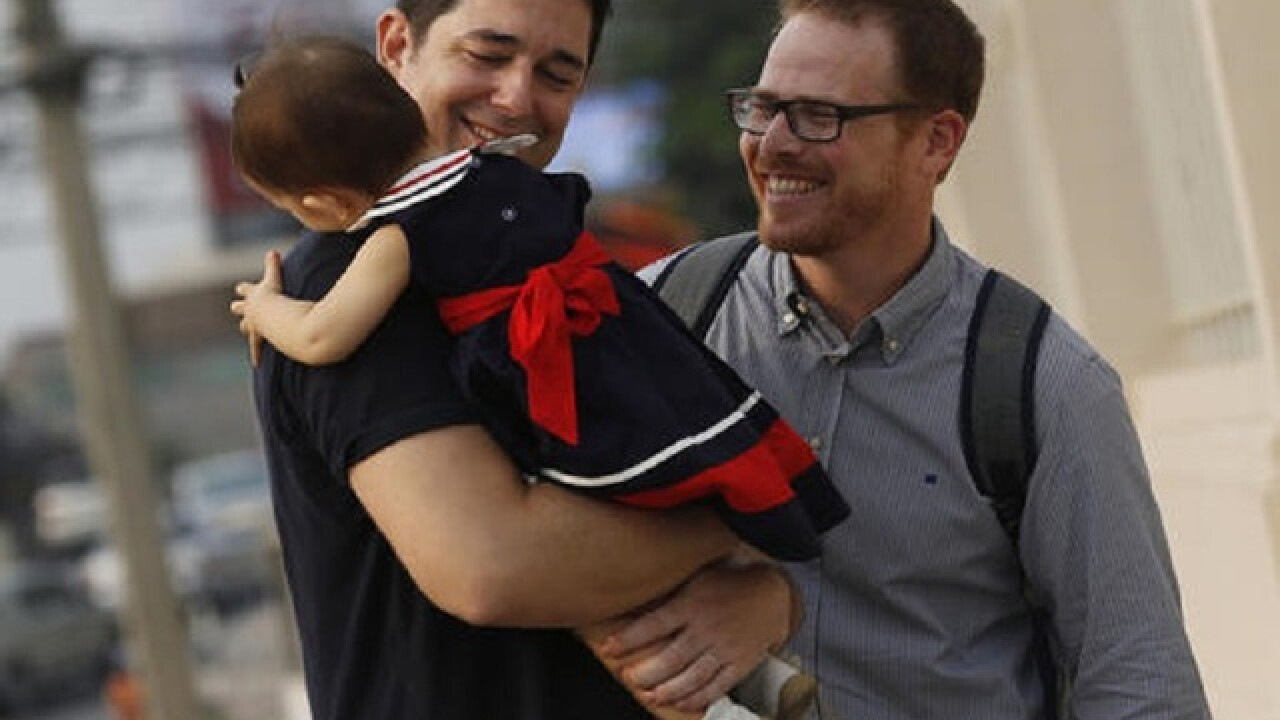 Gay Thai couple wins high-profile custody battle