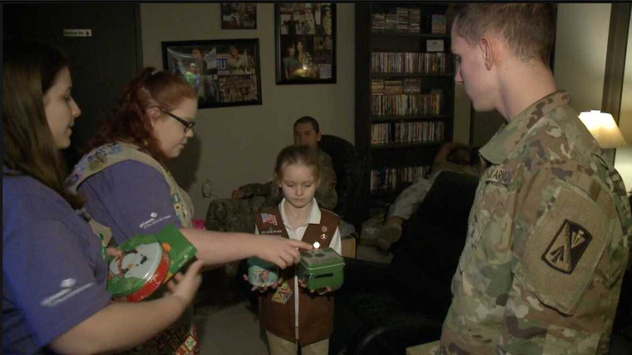 Girls Scouts hand out free holiday treats to military members at Norfolk InternationalAirport