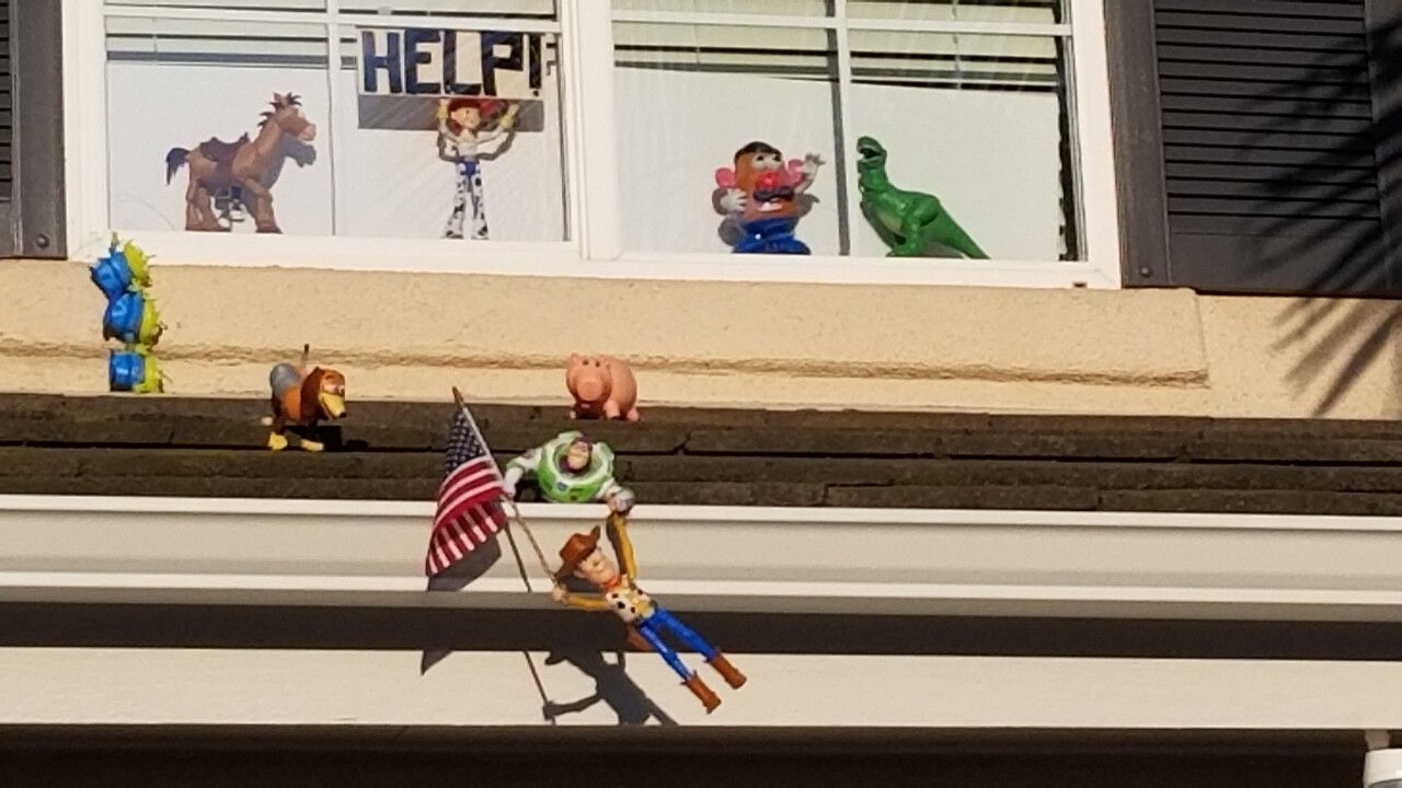 CA: COVID: COUPLE SPREADS JOY WITH TOY STORY SCENE