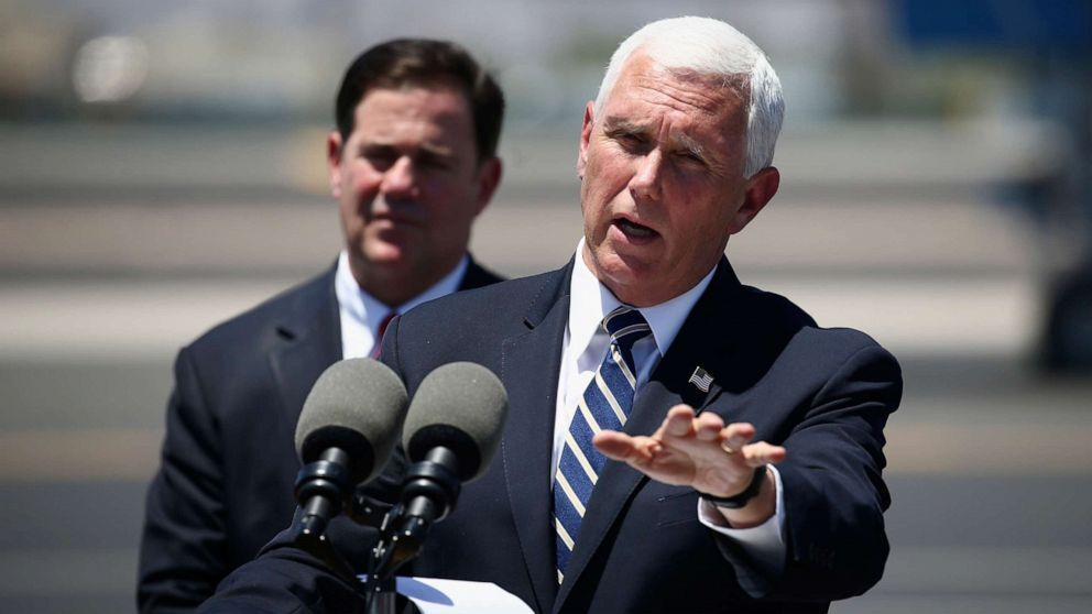 Vice President Mike Pence, right, answers a question as he holds a news conference with Arizona Gov. Doug Ducey, left, after their meeting to discuss the surge in coronavirus cases in Arizona... moreVice President Mike Pence, right, answers a question as he holds a news conference with Arizona Gov. Doug Ducey, left, after their meeting to discuss the surge in coronavirus cases in Arizona Wednesday, July 1, 2020, in Phoenix.