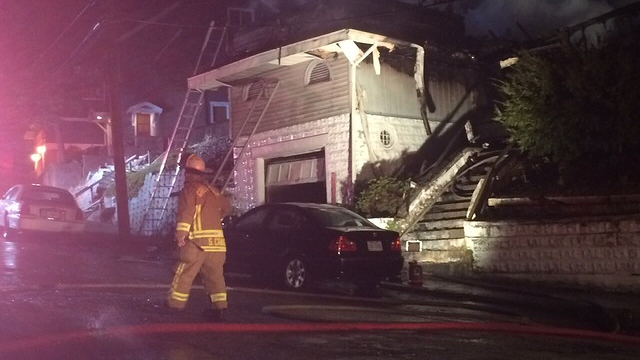 Aurora fire sends 2 to hospital, woman missing