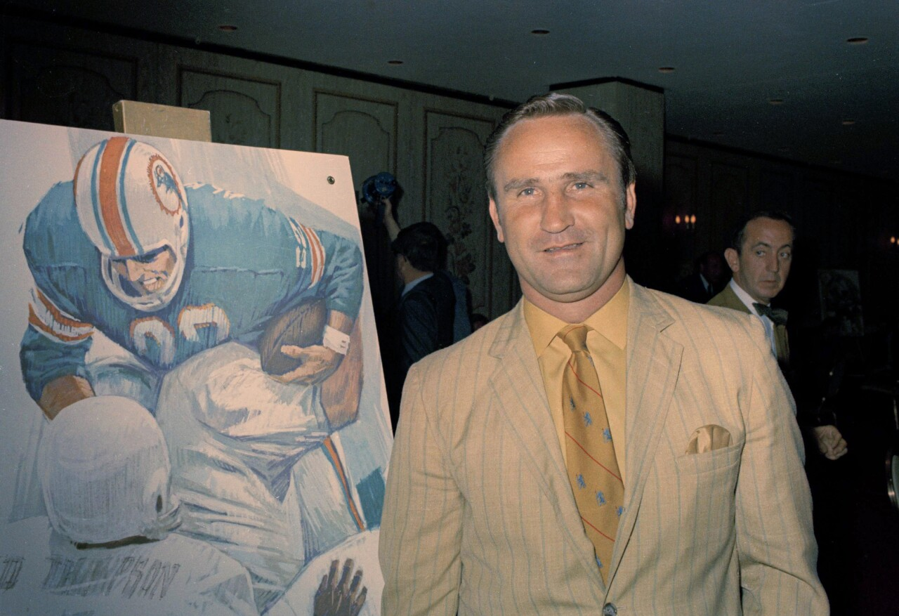 Don Shula poses with Dolphins poster after becoming head coach in 1970