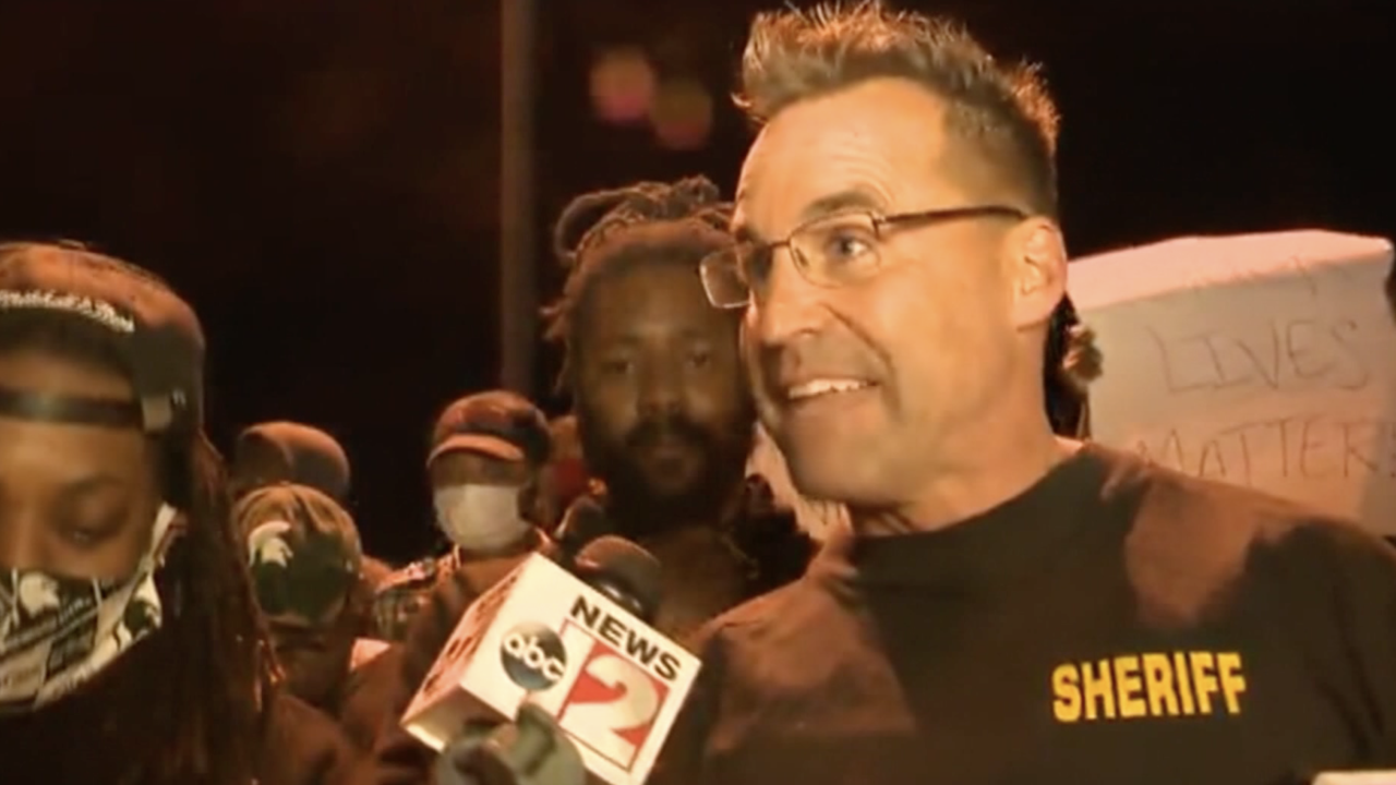 Sheriff joins group protesting police brutality after Floyd death : 'These cops love you'