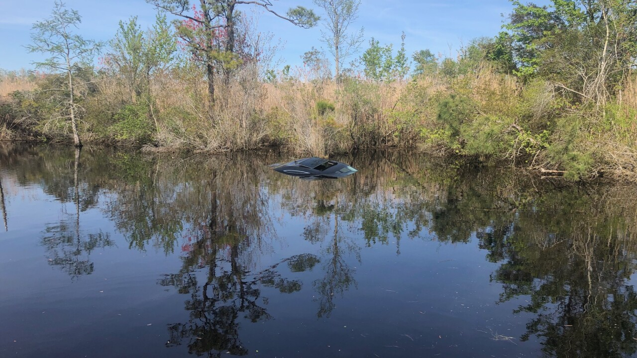 Coast Guard Chief saves woman from submerged car in Currituck Co. canal