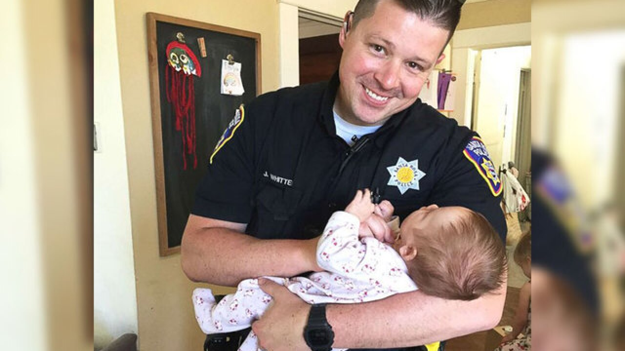 Police officer adopts baby from homeless woman