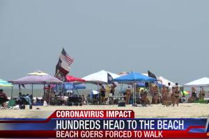 Hundreds hit the beach despite parking restrictions